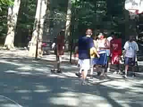 Ballers in Central Park playing Basketball on the court close to the Great Lawn on a sunday.