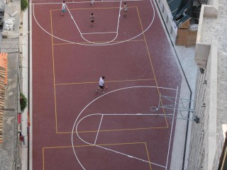 A rooftop basketball court on the ancient city walls of Dubrovnik