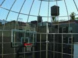 A rooftop basketball court at 5 Centre Market Place