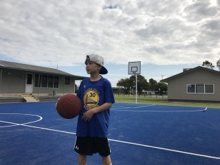Milo hooping on the blue court in New Zealand