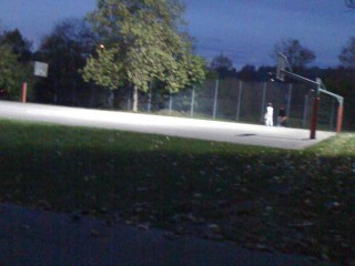 The basketball courts at night.