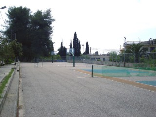 Tennis and basketball courts in Vartholomio, Greece.
