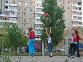 Some russian girls playing basketball.