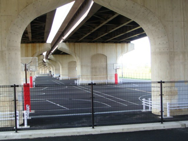 Another view of the courts under the bridge.