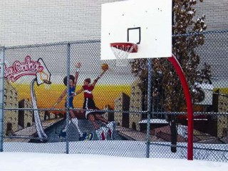 The basketball court at Parc Martel in Winter.