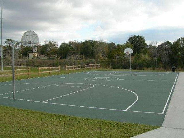 Streetball courts are located in the park right next to soccer facilities.