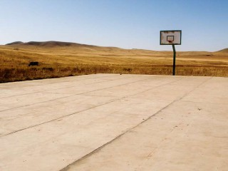 A lonely basketball court in Mongolia.